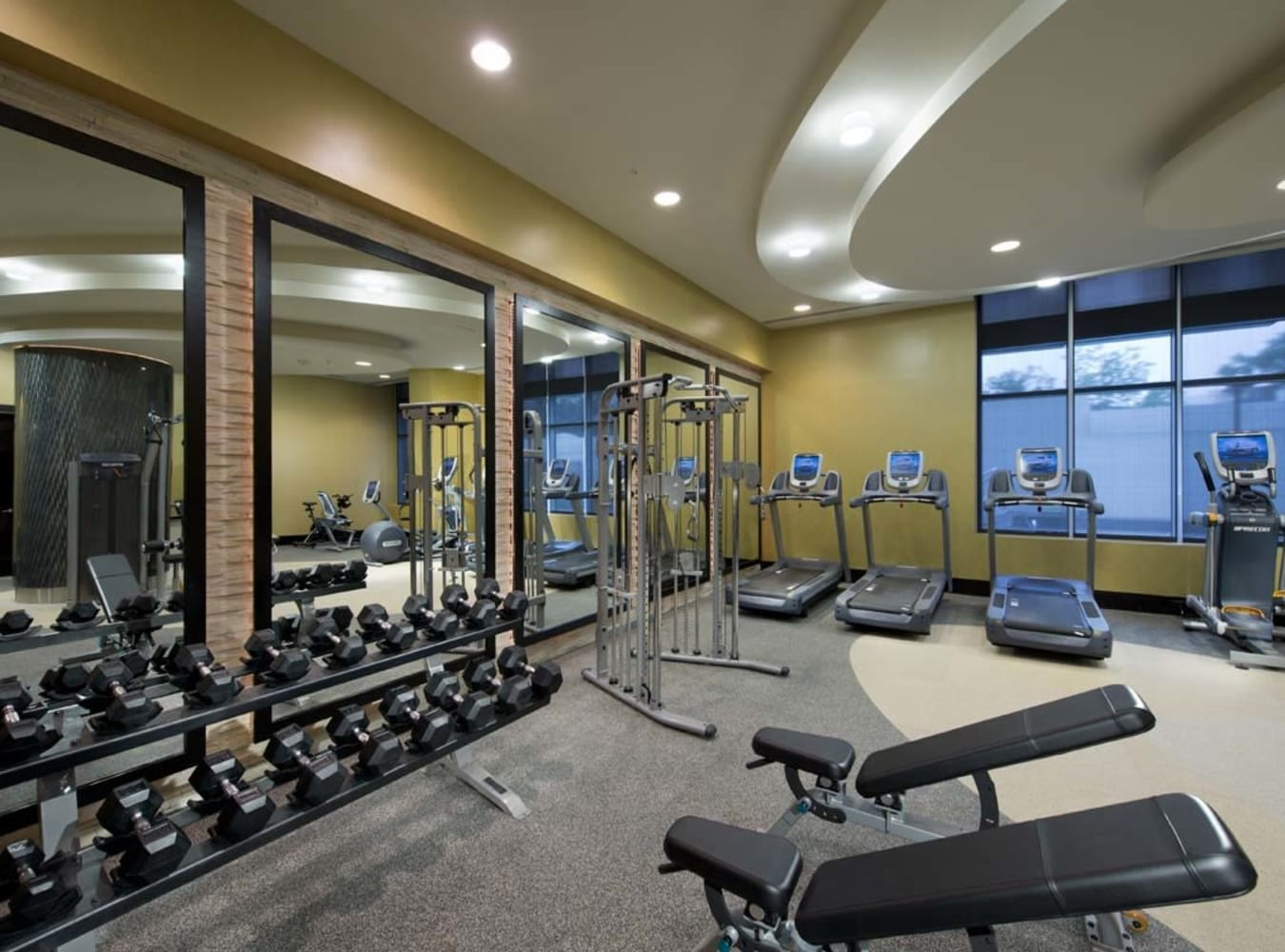 A fitness center with individual workout stations at Solaire 1150 Ripley in Silver Spring, Maryland