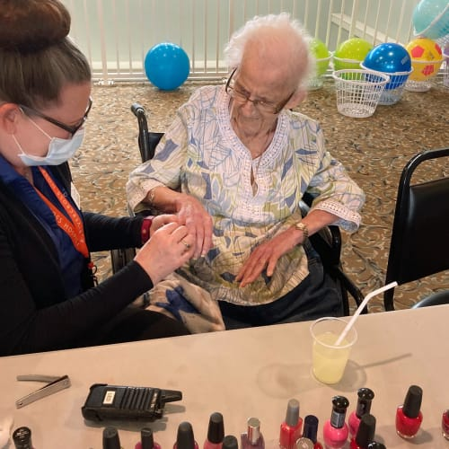 Resident getting her nails done at Canoe Brook Assisted Living & Memory Care in Catoosa, Oklahoma