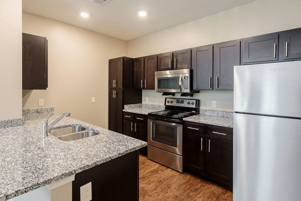 Kitchen with stainless-steel appliances at Canal Crossing in Camillus, New York