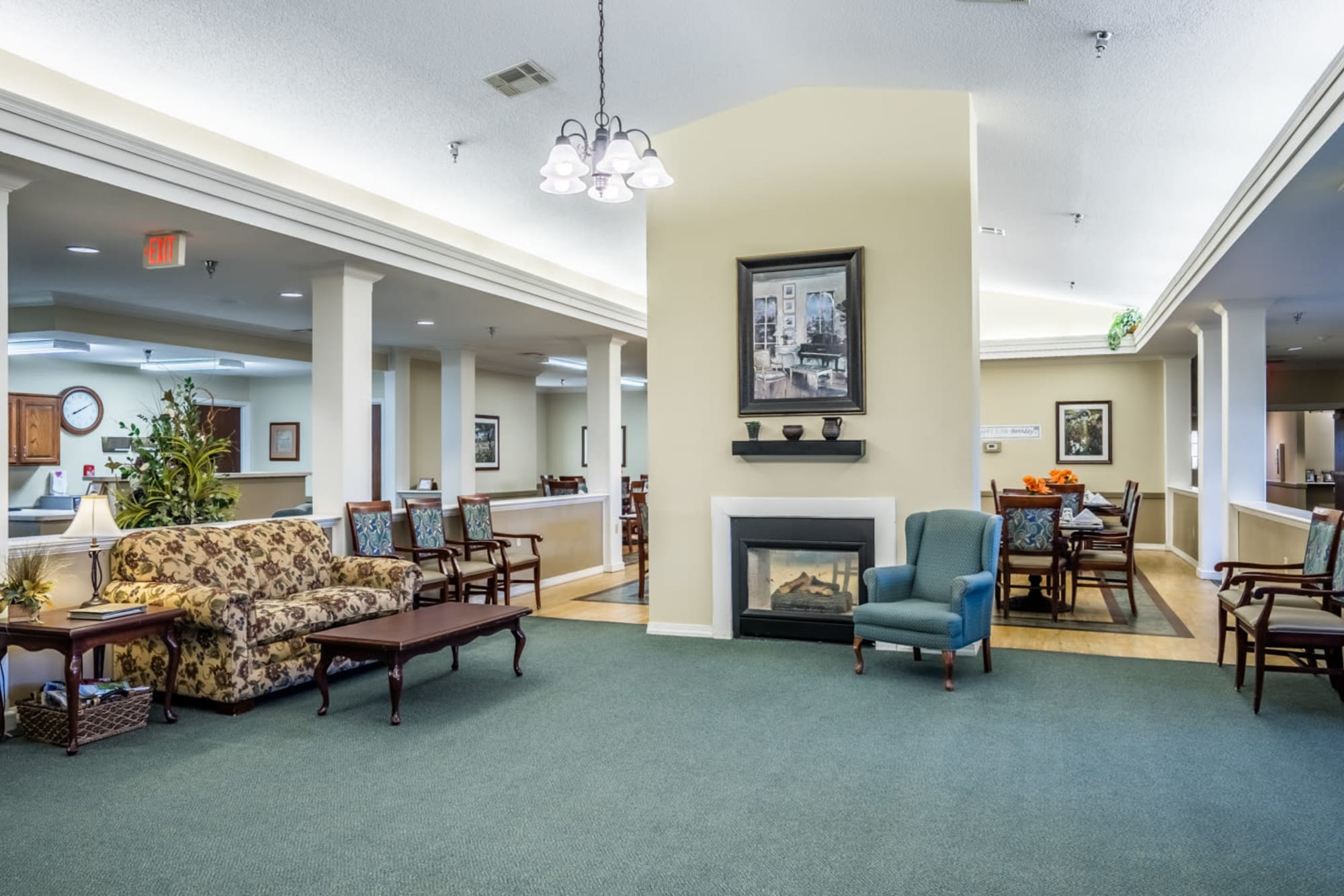 Upscale lounge with fireplace at Madison House in Norfolk, Nebraska.