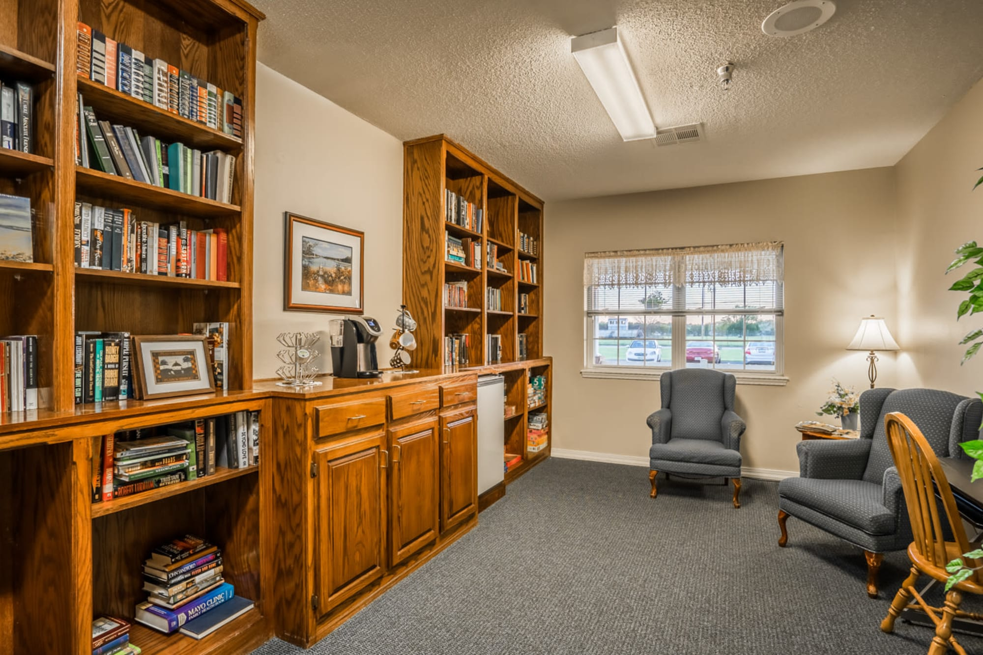 Library with wood accents at Madison House in Norfolk, Nebraska.