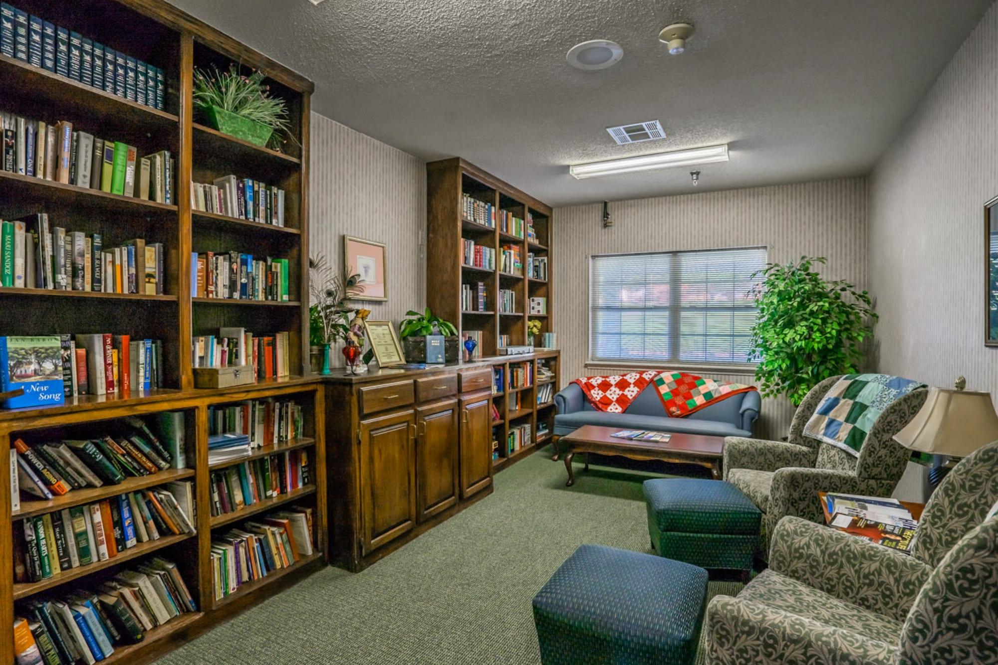 Library room with elegant wood bookshelves at Saunders House in Wahoo, Nebraska