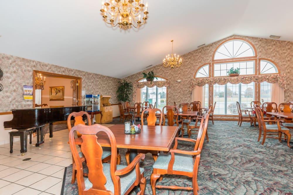 Elegant dining area complete with chandeliers at Brookstone Estates of Paris in Paris, Illinois