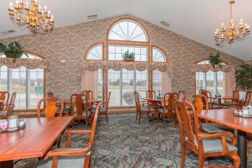 Elegant dining room with beautiful window and chandelier at Brookstone Estates of Paris in Paris, Illinois