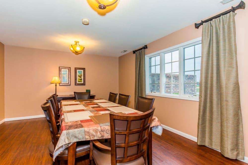 Quaint dining room with hardwood floors at Brookstone Estates of Olney in Olney, Illinois