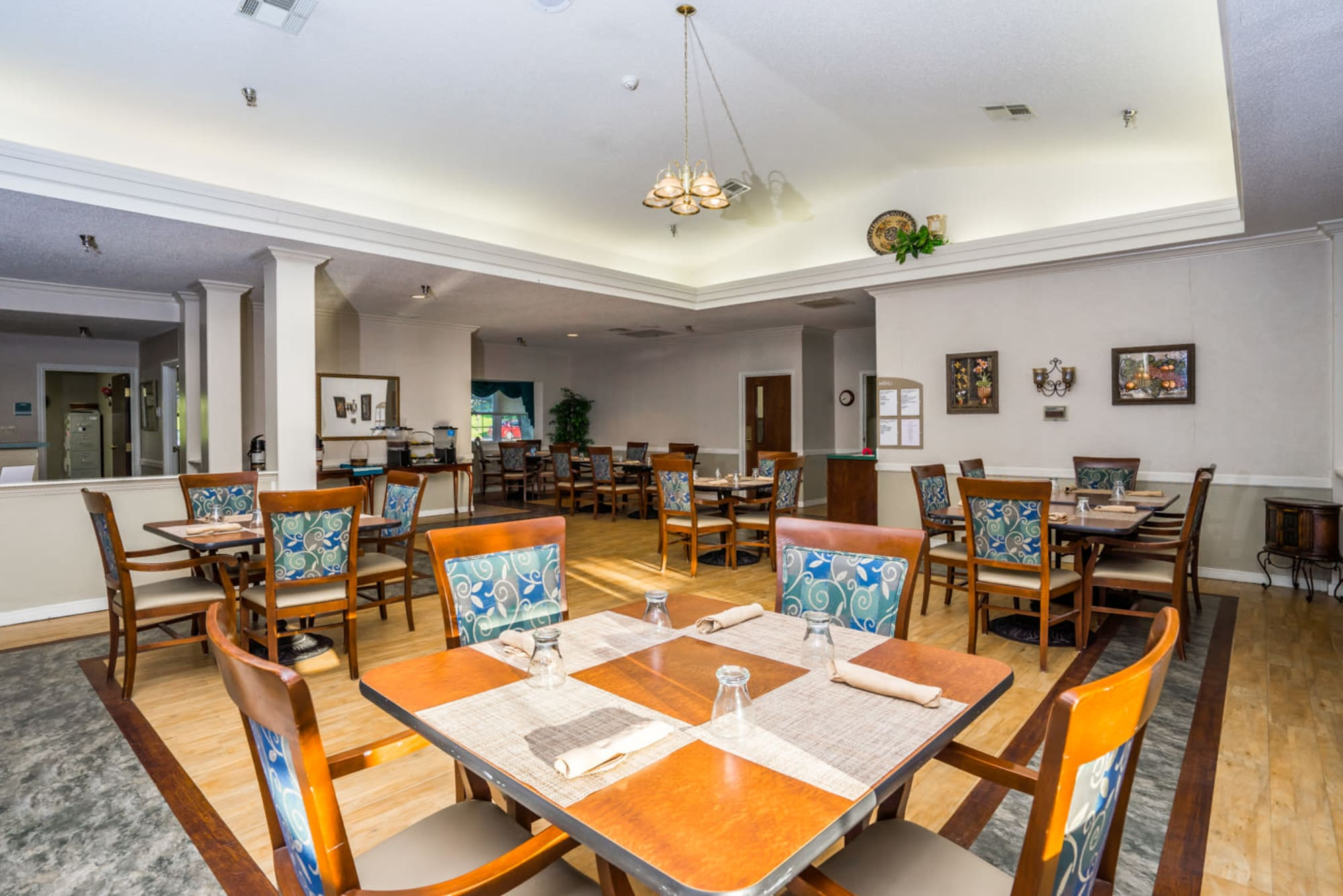 Elegant dining room with wood accents at Saunders House in Wahoo, Nebraska.