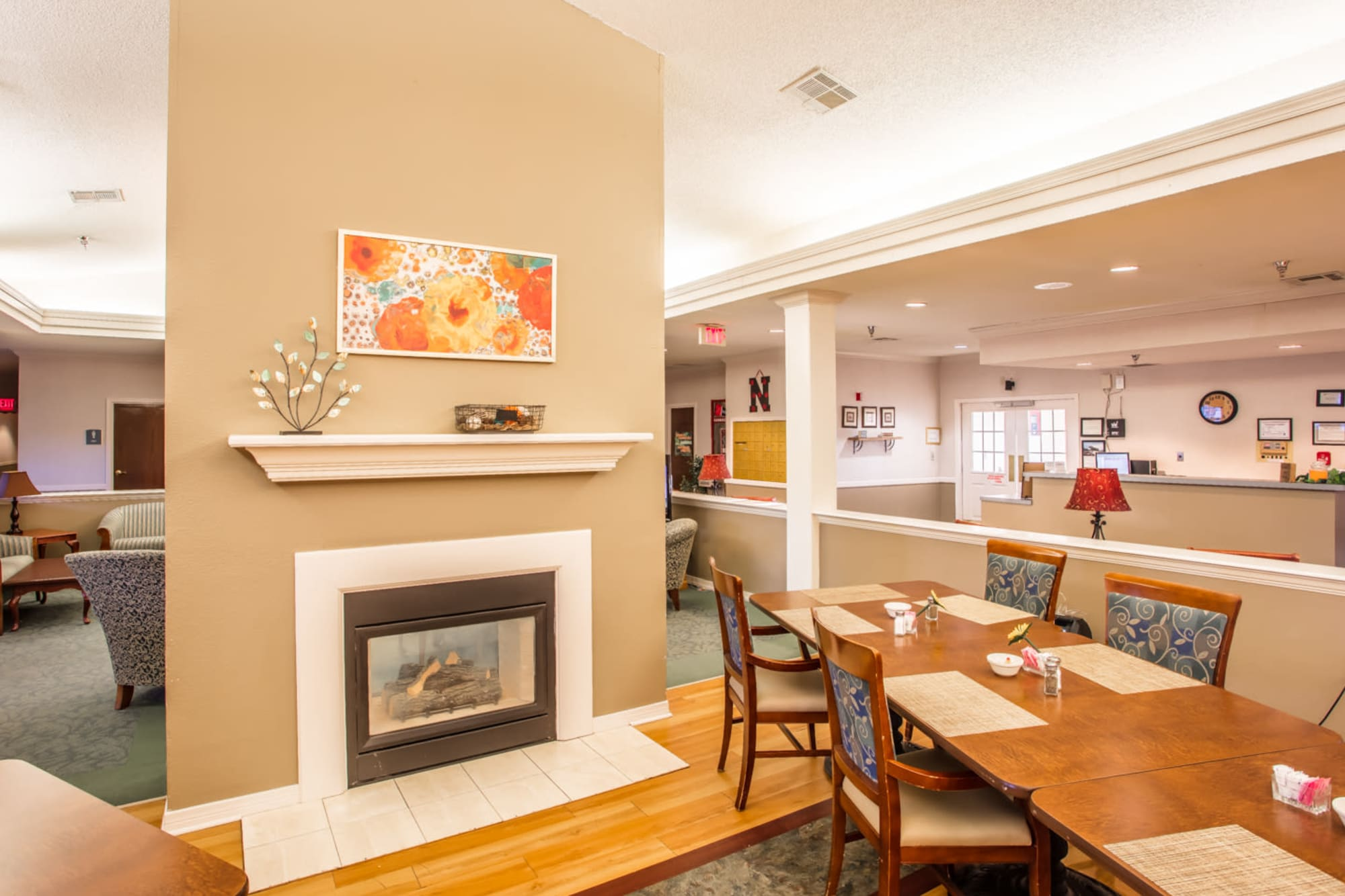 Dining area complete with bright lighting and fireplace at Homestead House in Beatrice, Nebraska.