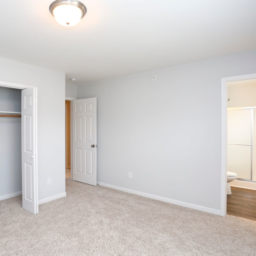 Bedroom with large closet and bathroom at Rippling Stream Townhomes in Durham, North Carolina