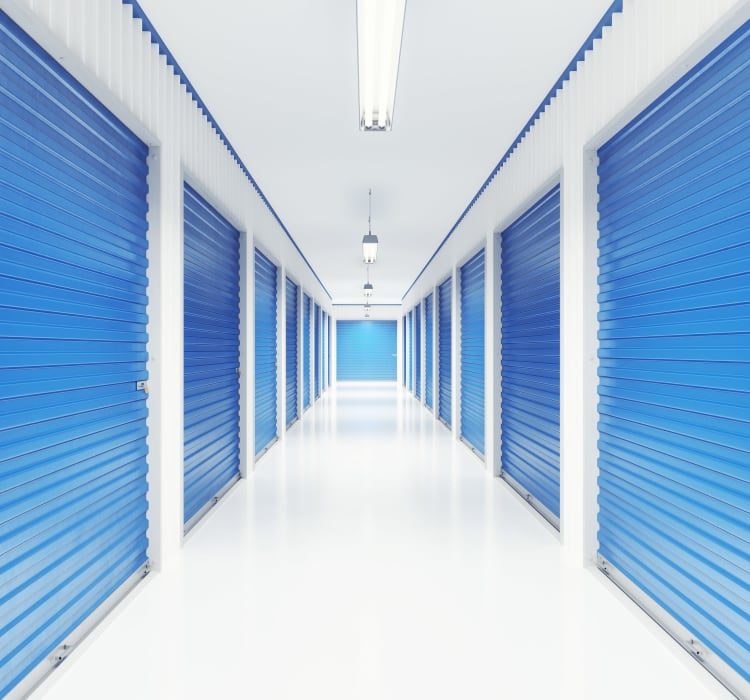 Bright and clean interior storage unit hallway at American Value Storage in San Antonio, Texas