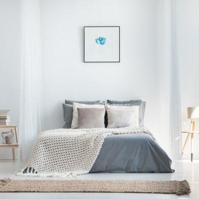 Minimalist bedroom decor in a model home at Sofi Ventura in Ventura, California