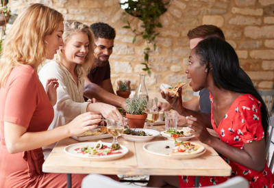 Residents enjoying happy hour at a near by restaurant at The Hamptons at Town Center in Germantown, Maryland