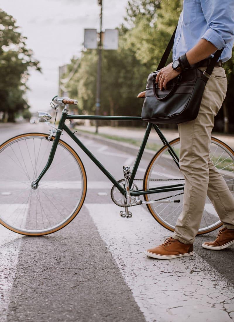 Resident walking his bike near Marquis at Canyon Ridge in Austin, Texas
