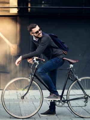 A man biking to work from his apartment at Harborside Marina Bay Apartments in Marina del Rey, California