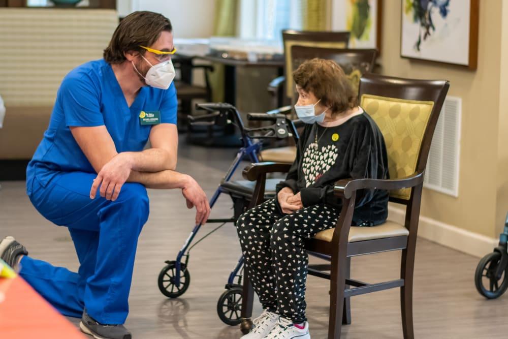 senior resident speaking with a nurse