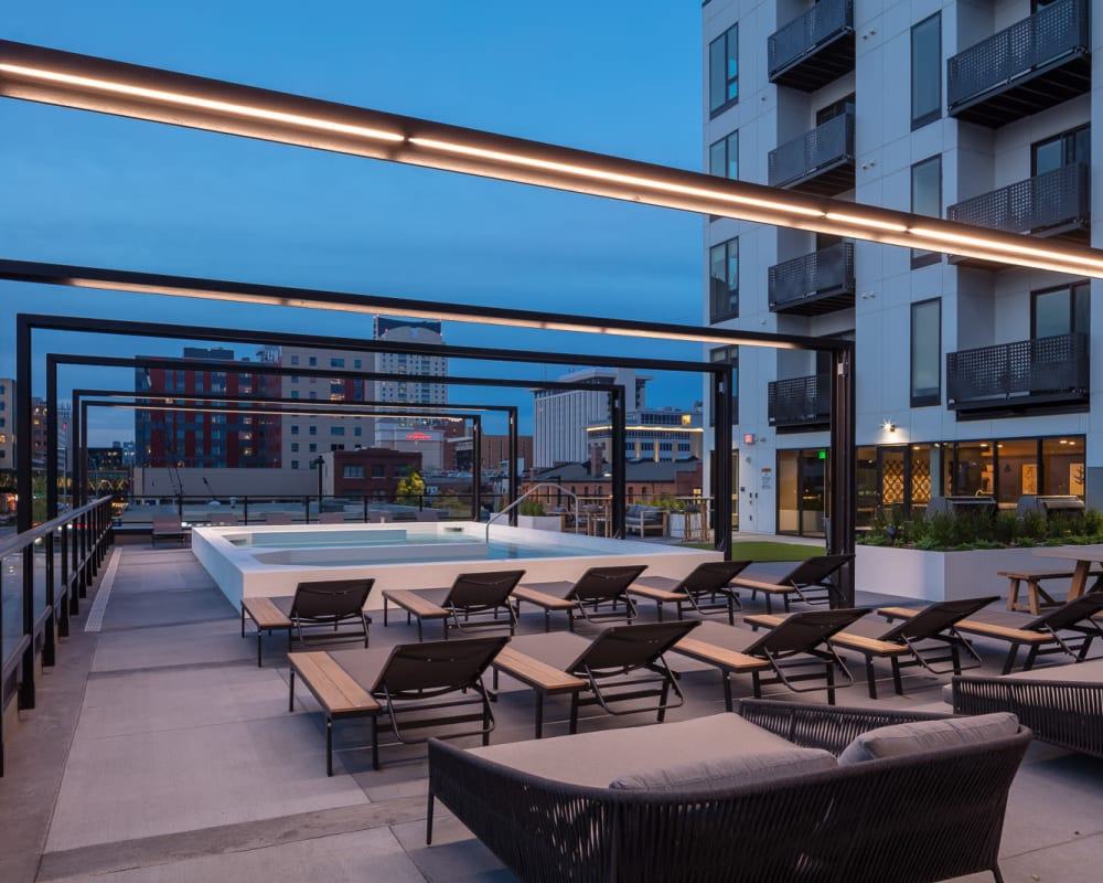 Spa deck at night at The Maven on Broadway in Rochester, Minnesota