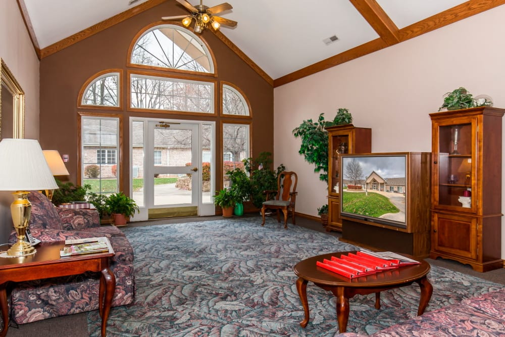 TV room complete with large window and wood accents at Brookstone Estates of Paris in Paris, Illinois