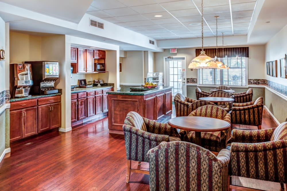 Lounge seating with kitchen island and beverage dispensers at Grand Victorian of Rockford in Rockford, Illinois