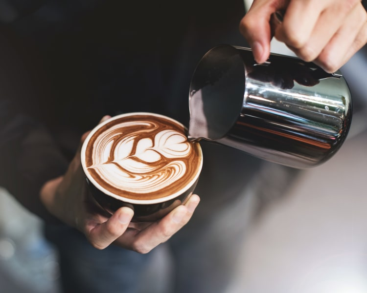 Barista making a latté for a customer near Sofi Belmont Glen in Belmont, California
