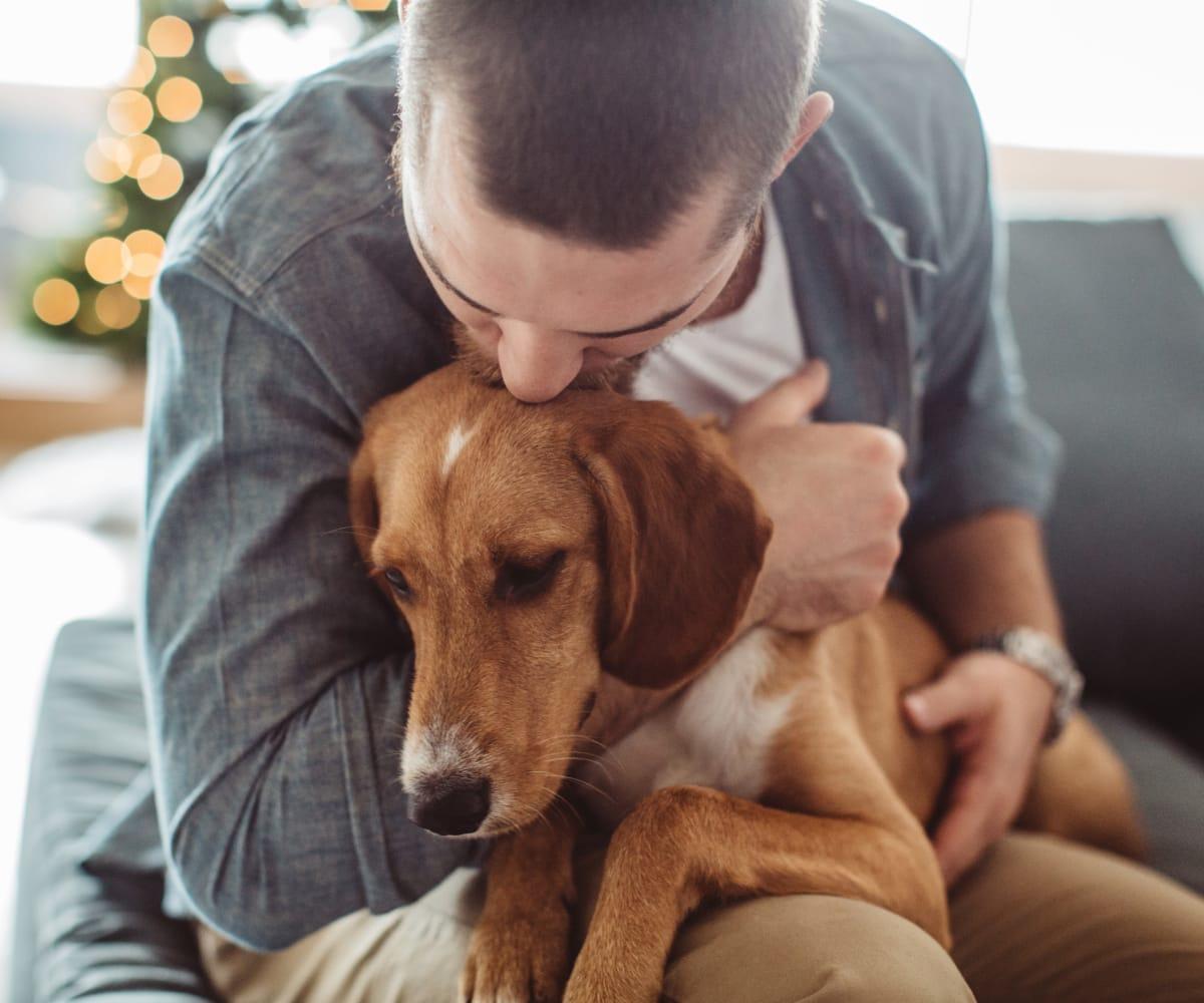 Resident holding his dog at Fox Run Apartments in Wichita, Kansas