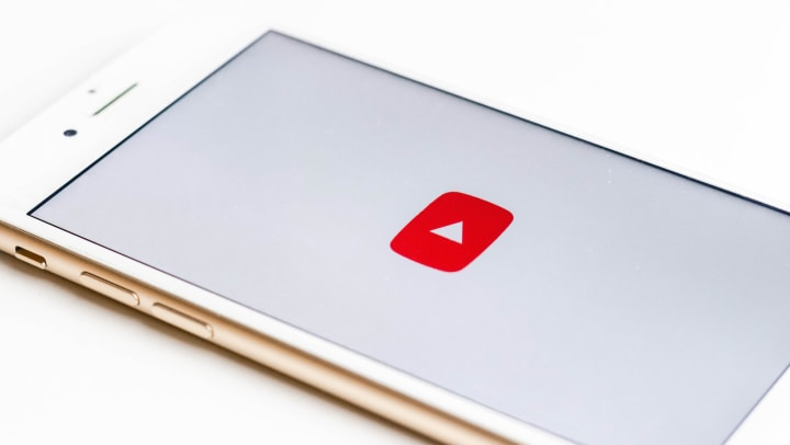smartphone with youtube logo across the screen