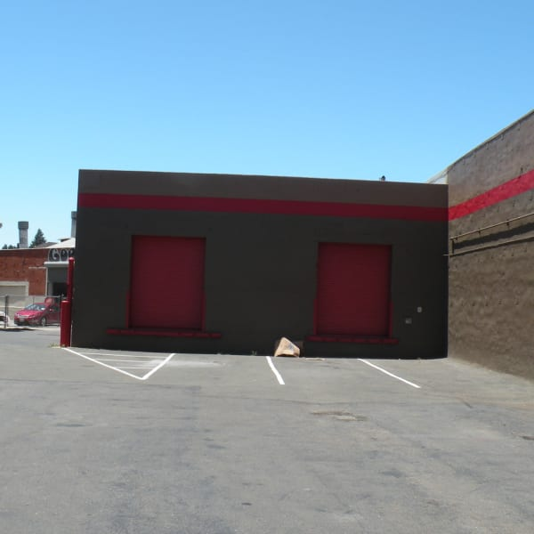 Exterior ground-level units at StorQuest Self Storage in Oakland, California