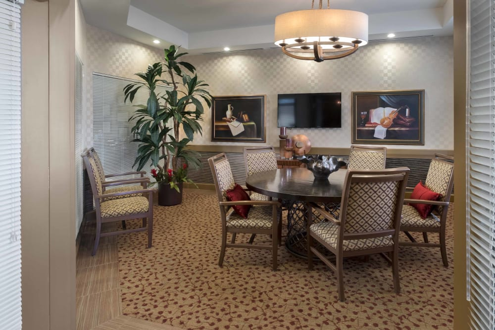 Seating in an entertainment room at Avenir Memory Care at Chandler in Chandler, Arizona