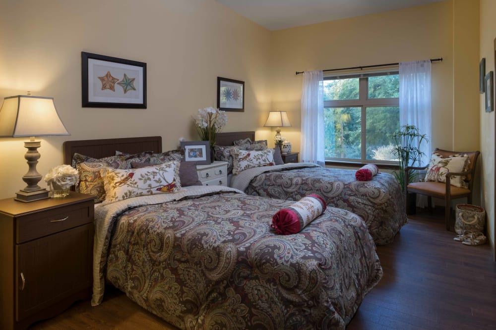 A shared bedroom at Avenir Memory Care at Chandler in Chandler, Arizona