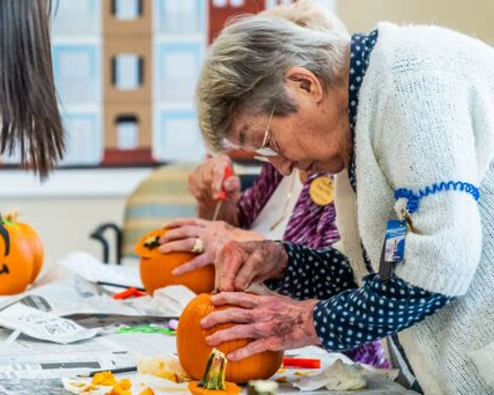 A resident paints a pumpkin at Harmony at West Ashley in Charleston, South Carolina