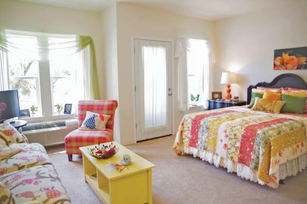 Bedroom and living room at Heatherwood Gracious Retirement Living in Tewksbury, Massachusetts