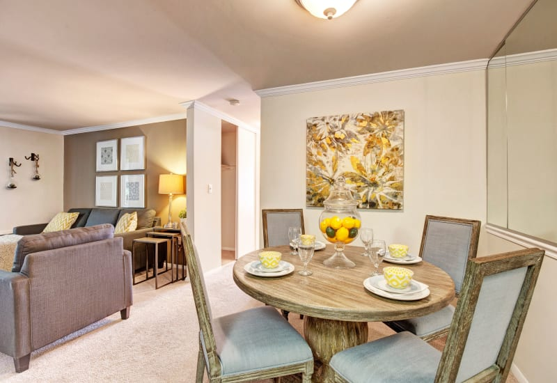 Dinning room adjacent to an open living room area at The Hamptons at Town Center in Germantown, Maryland