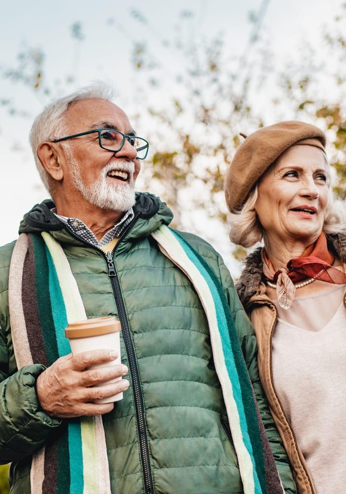 A man and women take a walk near at Logan Creek Retirement Community in Mount Vernon, Washington
