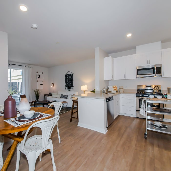 View of open-concept floor plan with hardwood floors in model home at IMT Sherman Circle in Van Nuys, CA