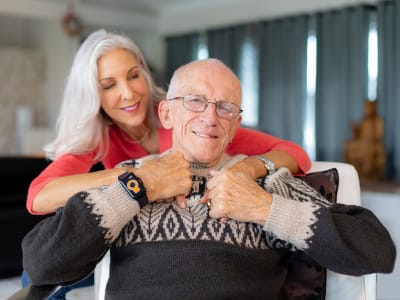 Senior gentleman with a loved one wearing CarePredict