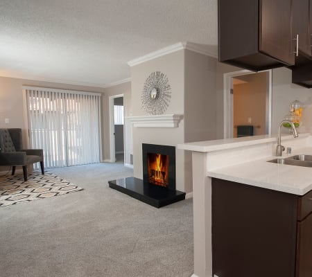 Luxury living room with a fireplace at La Valencia Apartment Homes in Campbell, California