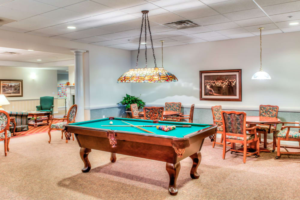 Deluxe billards table with ample game room seating at Grand Victorian of Sycamore in Sycamore, Illinois