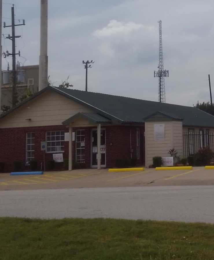 The exterior of the main entrance at StorQuest Self Storage in Sugar Land, Texas