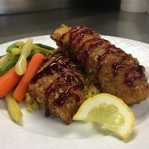 Fried chicken with vegetables served at First & Main of Auburn Hills in Auburn Hills, Michigan
