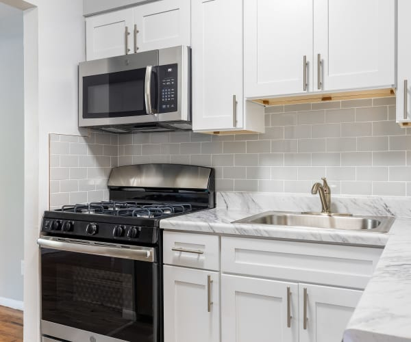 Sleek modern kitchen at Mid Island Apartments in Bay Shore, New York