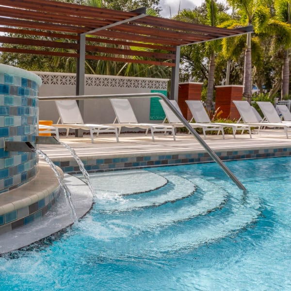 Chaise lounge chairs around the pool at 50 Paramount in Sarasota, Florida