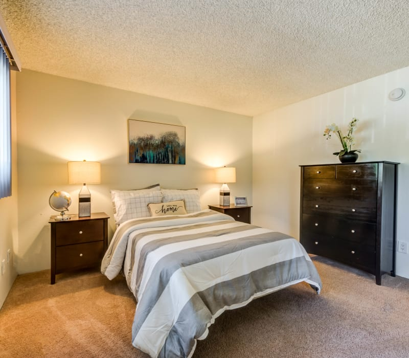 A spacious carpeted bedroom at Cypress Point in Northridge, California