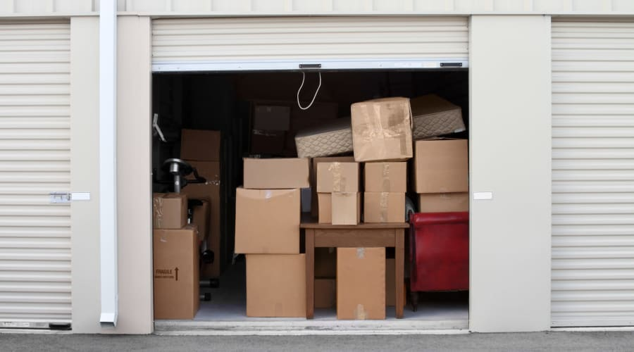 A storage unit filled with boxes at KO Storage of Cass County in Pillager, Minnesota