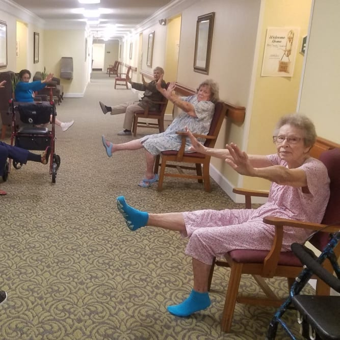 Seniors maintaining social distancing at Grand Villa of Boynton Beach in Boynton Beach, Florida