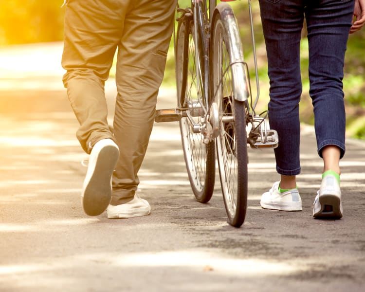 couple walking with bike near Regatta Bay
