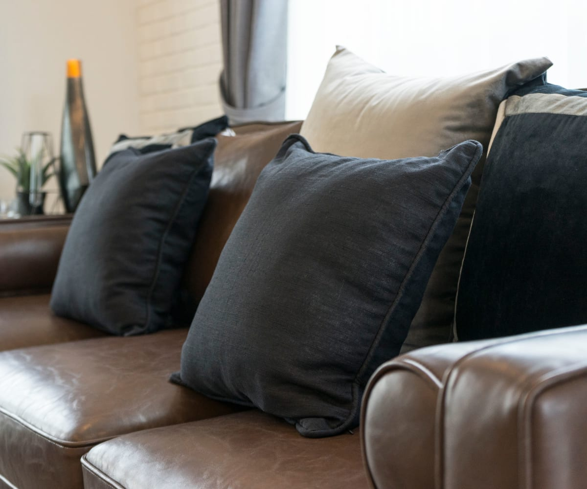 Leather couch at Persimmon Square Apartments in Oklahoma City, Oklahoma