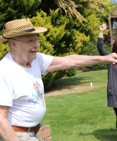 Resident celebrating after throwing horseshoe at The Springs at Sunnyview in Salem, Oregon