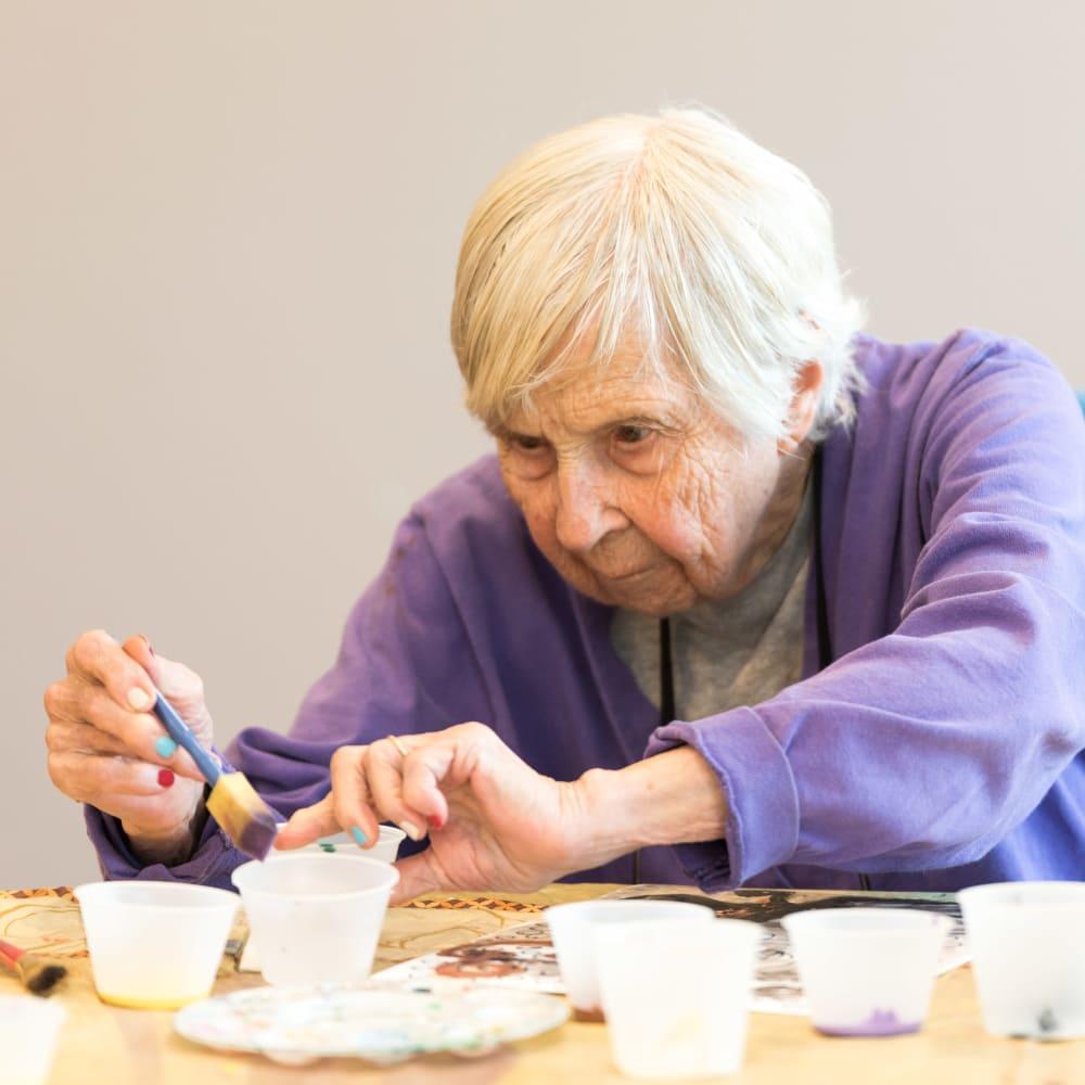 Resident making an art project at Inspired Living Bonita Springs in Bonita Springs, Florida.