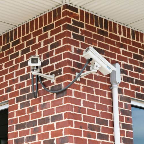 Security cameras outside climate-controlled units at Red Dot Storage in Sycamore, Illinois