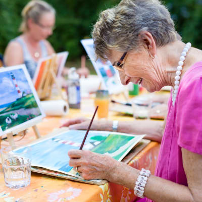 Resident taking an art class at Westminster Memory Care in Lexington, South Carolina