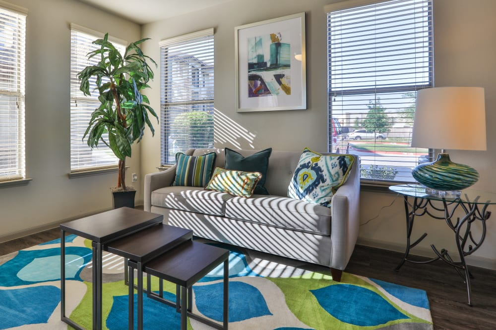 Well-furnished living space in a model home at Olympus at Waterside Estates in Richmond, Texas