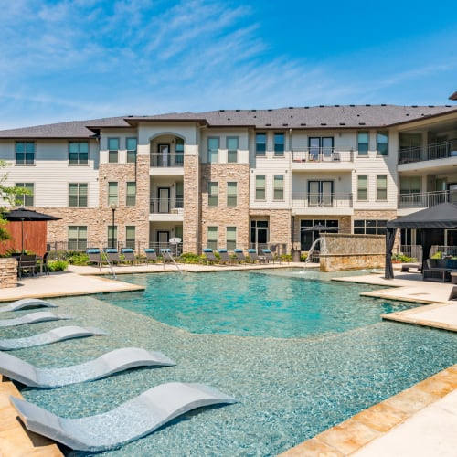 Sparkling pool at Olympus at Waterside Estates in Richmond, Texas